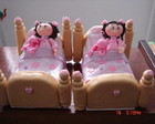 BONECA EM BISCUIT  COM A UNIQUA NA CAMA
