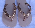 havaiana dourada com couro