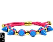 Pulseira de spikes color pink/blue