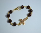 Pulseira animal print crucifixo