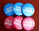 "Broches ""Team Groom"" e ""Team Bride"""