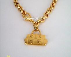 pulseira bolsinha dourada