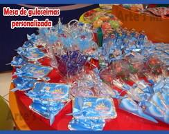 Mesa de guloseimas e doces personalizado