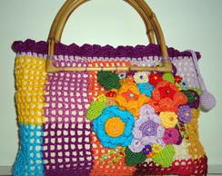 Bolsa de m�o multicolorida com flores