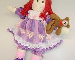 Boneca com ursinho.