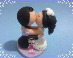 Casal de noivinhos beijando 5cm