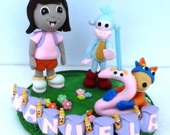 Topo de bolo com vela Dora Aventureira