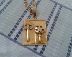 medalha dos orixas Ogum e oxum banhado