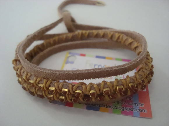 Pulseira em couro-esgotada