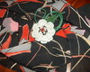 Broche de flor de crochê bordada