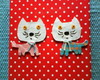 Broche gatos.