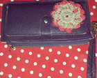 Clutch roxa customizada em croche