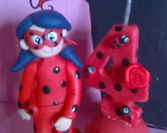 mini topo com vela lady bug.
