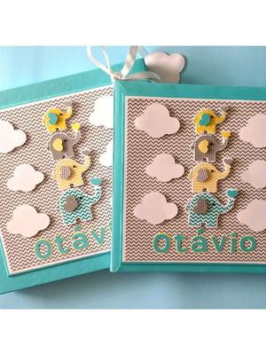 Livro do bebê menino com caixa elefantinhos coloridos