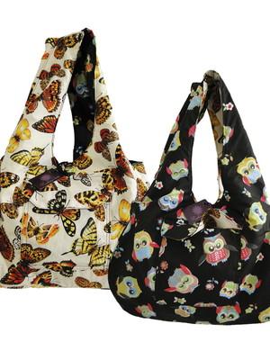 Bolsa dupla face com bolsos *