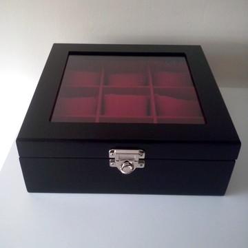 Porta relógio c/almofadinhas vermelhas.