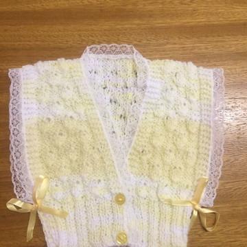 Colete de tricô para bebê