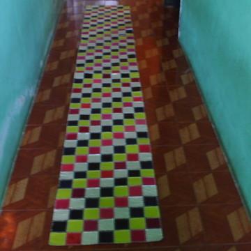 Passadeira feita com retalhos de couro