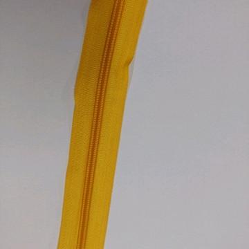 Zíper em metro amarelo ouro