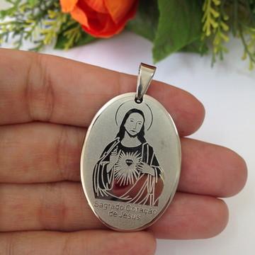 Pingente em aço oval Sagrado Coração de Jesus
