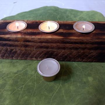 castiçal rústico com vela de cápsula de café
