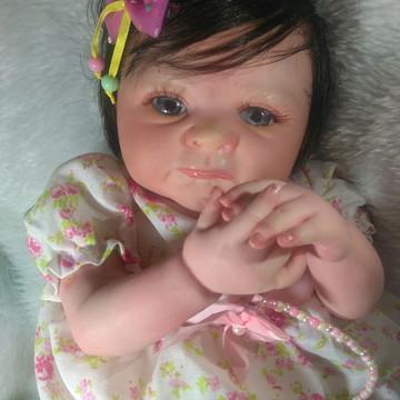 Bebê Reborn linda com olhos azuis
