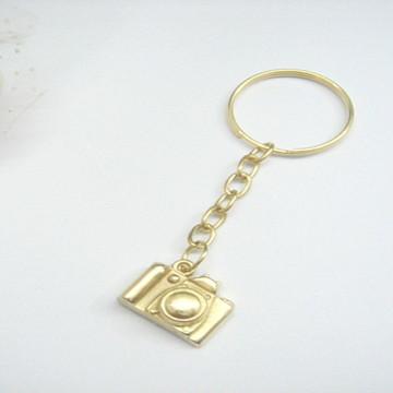 Chaveiro camera fotografia dourada