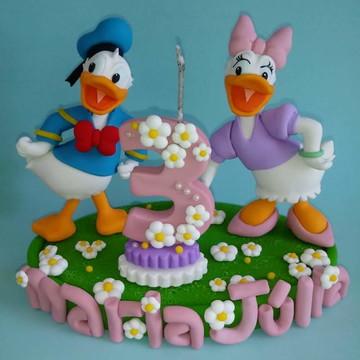 Topo de bolo com vela do Pato Donald e Margarida