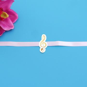 Fita com tag - foil - notas musicais - clave de sol