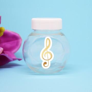 Baleiro de plástico - foil - notas musicais clave de sol