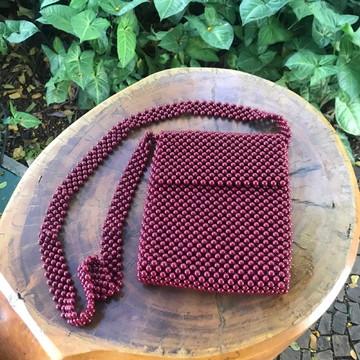 Bolsa de contas vermelha tiracolo
