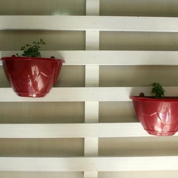 Suporte de parede para vasos