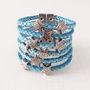 Bracelete-de-couro-azul-turquesa-e-estrelas-prata-bracelet