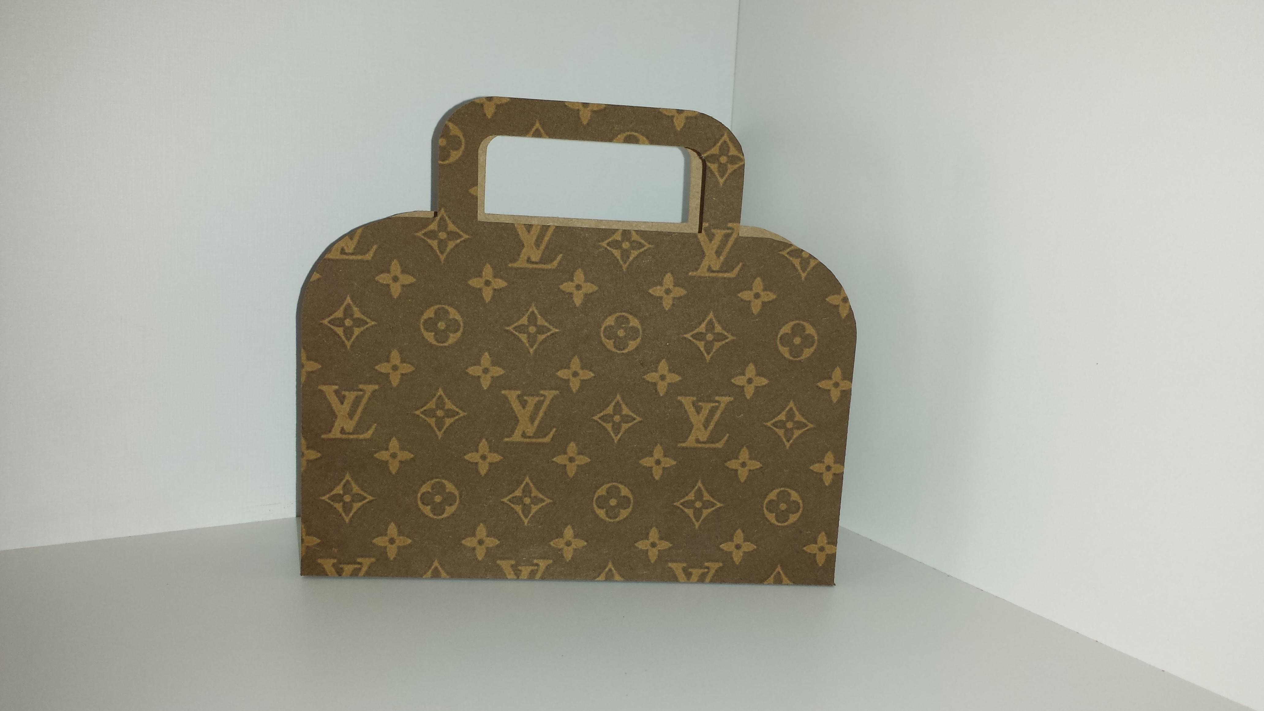 7abb0dc579e39 Centro de Mesa Louis Vuitton   Elo7