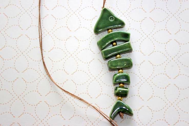 Design Of Colar de cerâmica - Peixe e preço