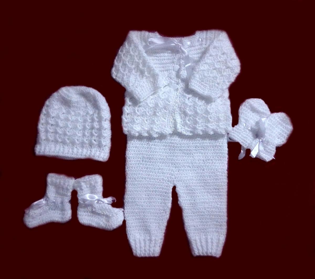 6663453de Zoom · Conjunto branco p  bebê